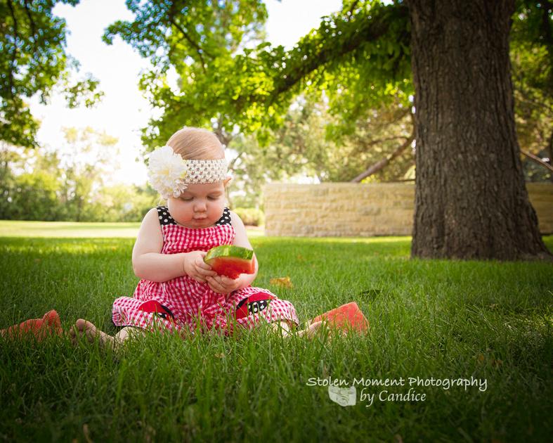one year old girl enjoying fruit