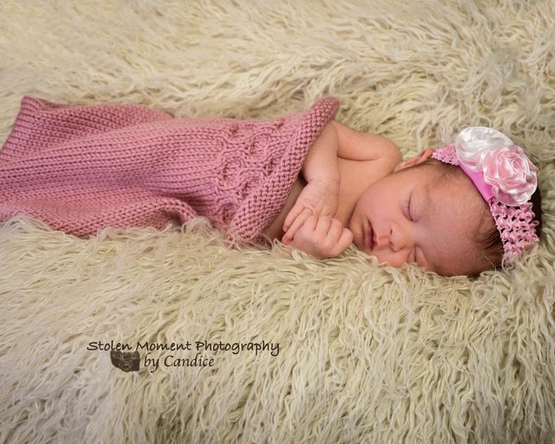 newborn girl sleeping in bunting bag