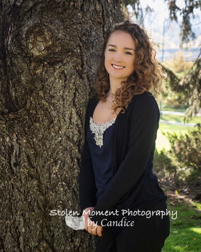 teenage girl posed at tree