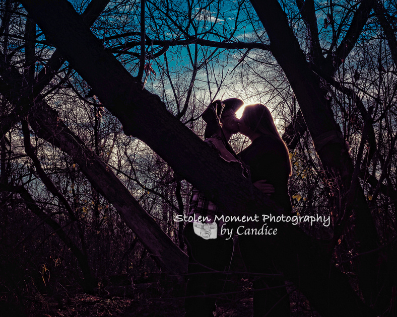 a silhouette shot of an engaged couple