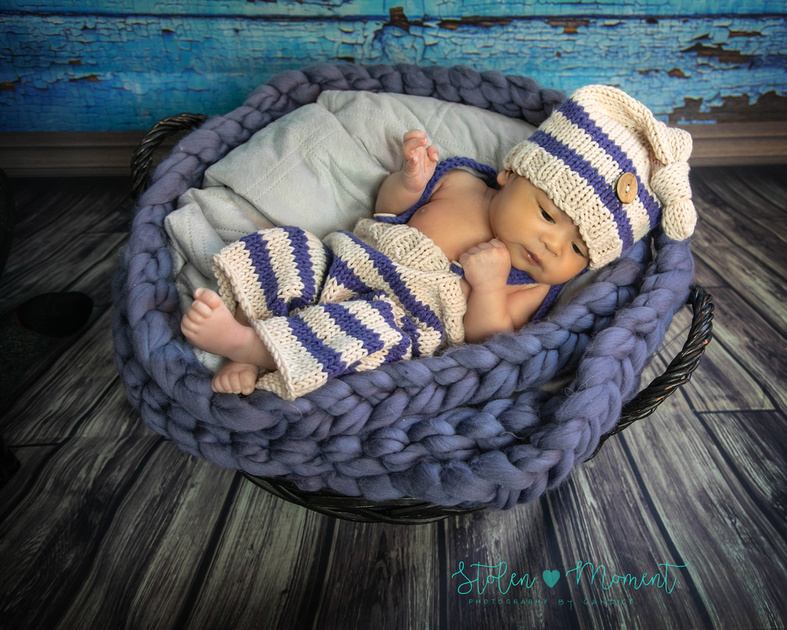a two week old newborn boy and his mommy and daddy