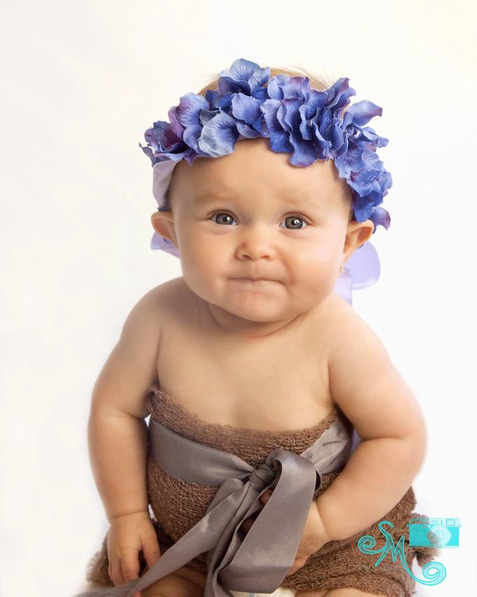 gerber-like baby with purple flower crown