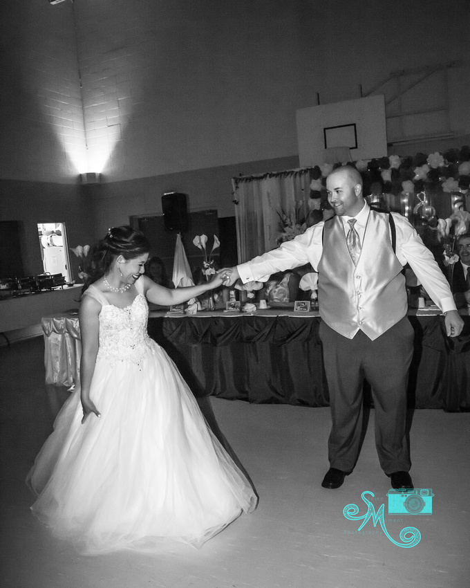 The bride and groom share a smile during their first dance