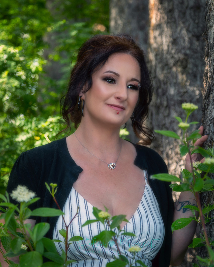 a gorgeous woman poses for photos at the St. Albert Botanical Gardens