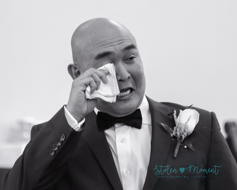 the groom wipes his eyes as his bride walks down the aisle