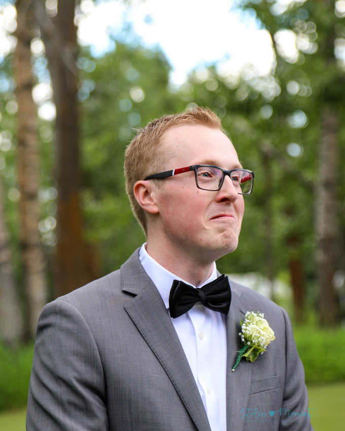 The groom's expression when he sees his bride walk down the aisle