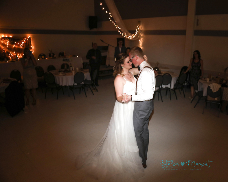 the bride and groom share their first dance together and only have eyes for each other