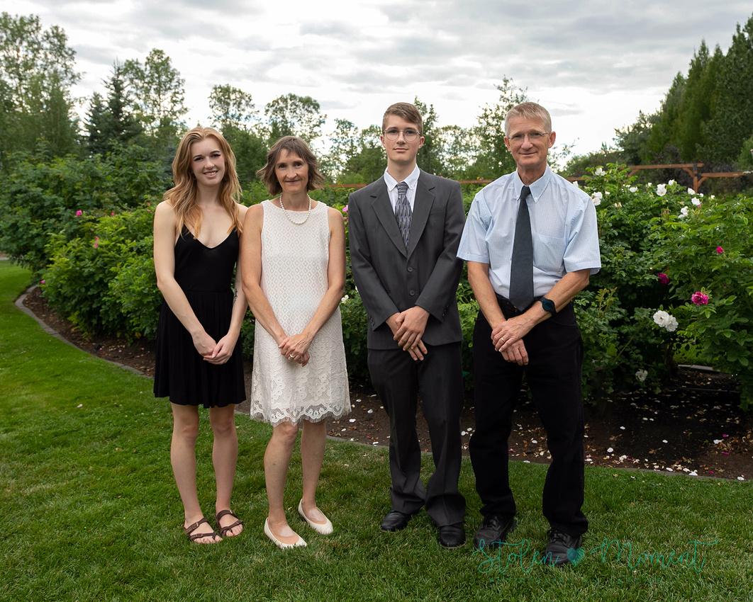 a grade twelve graduate poses for photos at the St. Albert Botanical Gardens