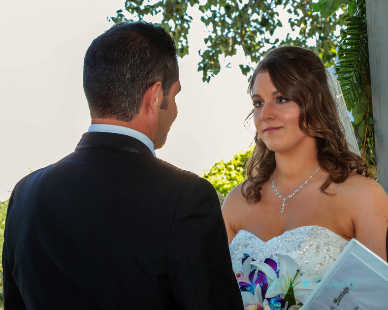 the bride looks into her groom's eyes as she says her vows