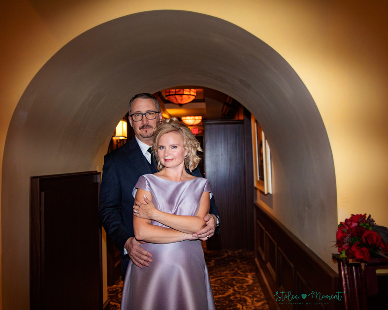 a couple are married in an elegant and intimate wedding ceremony at Ruth's Chris restaurant.