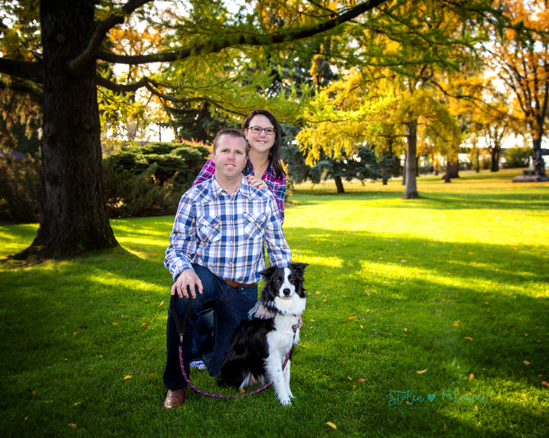 A mom, dad, two sisters aged 8 and 10 and their border collie dog have photos taken at the Alberta Legislature Grounds in the fall