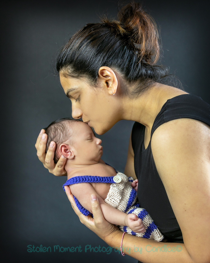 a mom and her one month old son photographed in studio