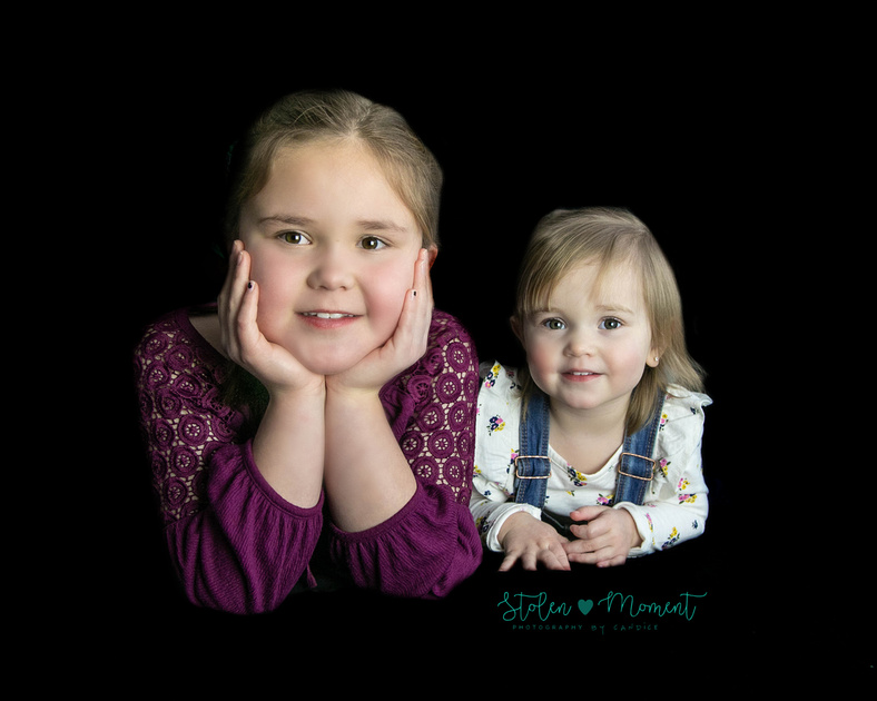 a Mom, Dad and their two daughters in studio for family photos plus two year old birthday photos with youngest girl.