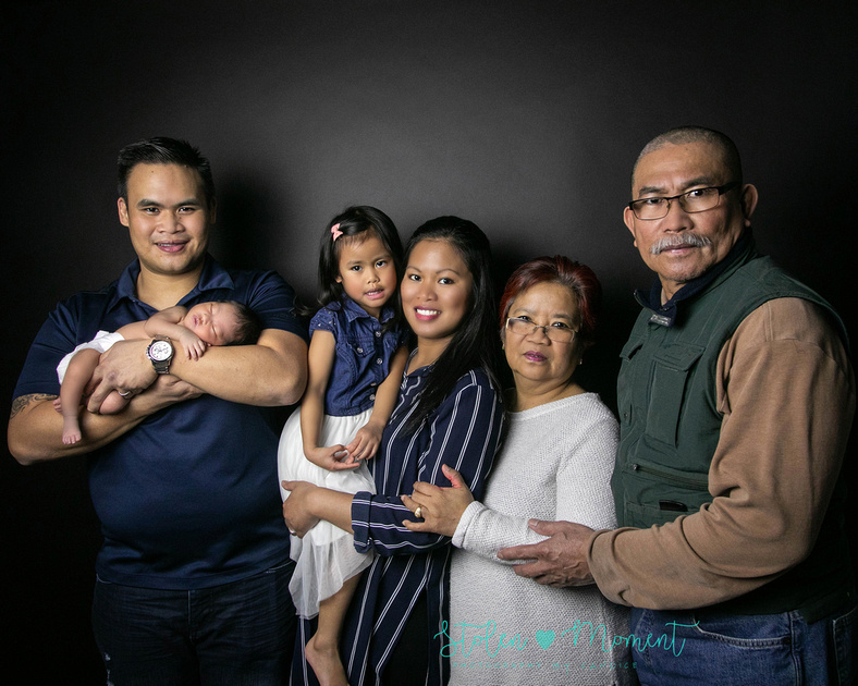 a seven day old newborn girl with her big sister, mom and dad and Grandma and Grandpa