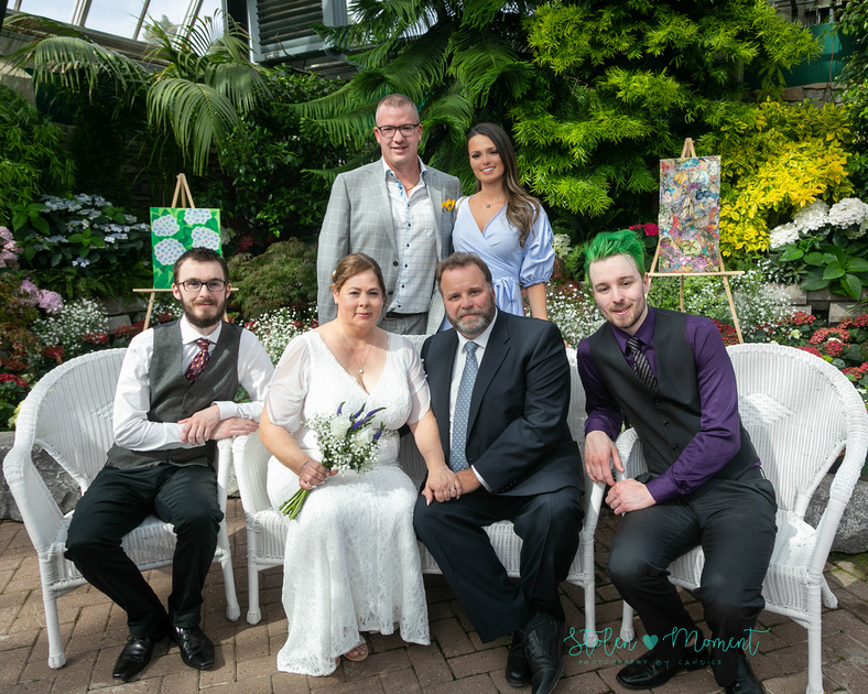 A couple wed in an intimate ceremony at the Muttart Conservatory in Edmonton