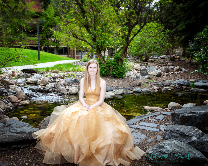 A beautiful grade twelve girl in her formal dress alone and with her family at the University of Alberta grounds