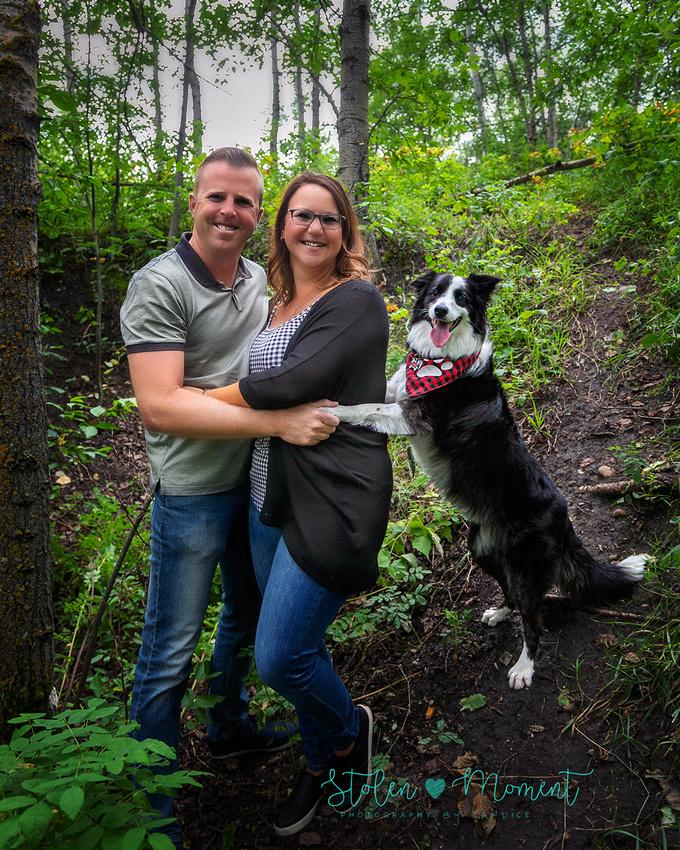 Family of four plus border collie pose for fun family photos at Buena Vista dog park