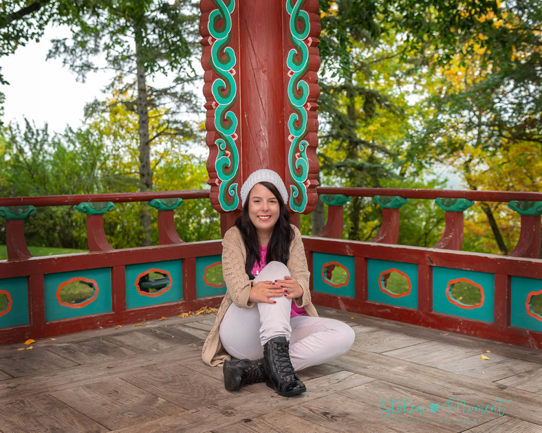 a beautiful young lady poses for photos at Government House in Edmonton