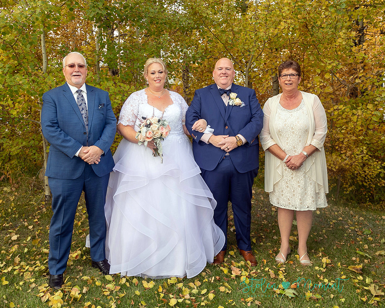 a cool couple with their wedding party at Woodbridge Park and the Canadian Dutch Club.