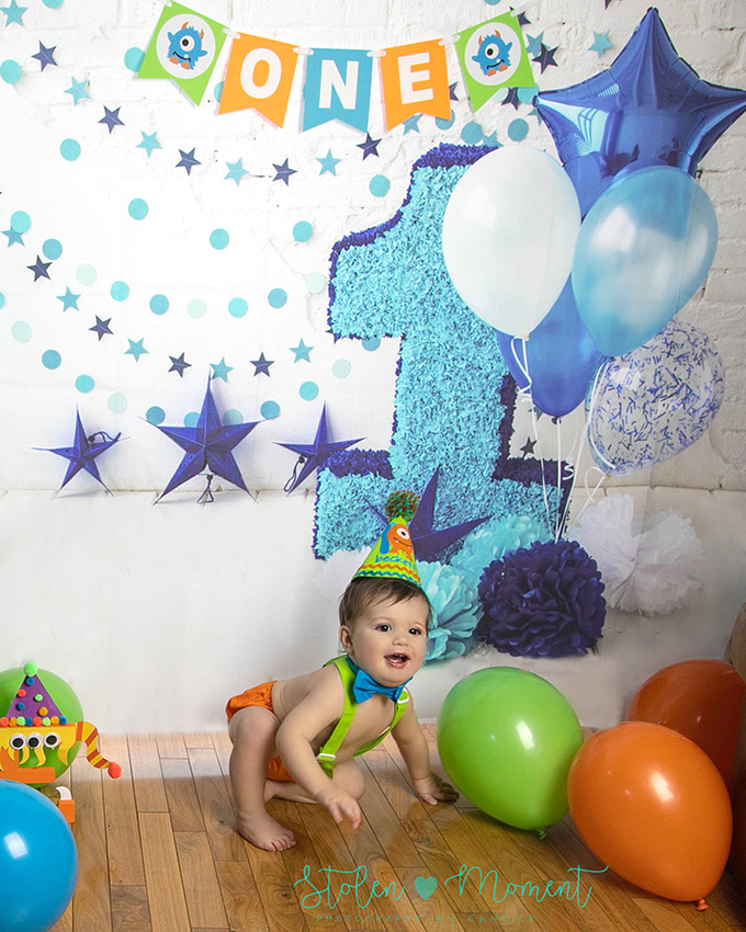 An adorable one year old boy enjoys his cake smash session.