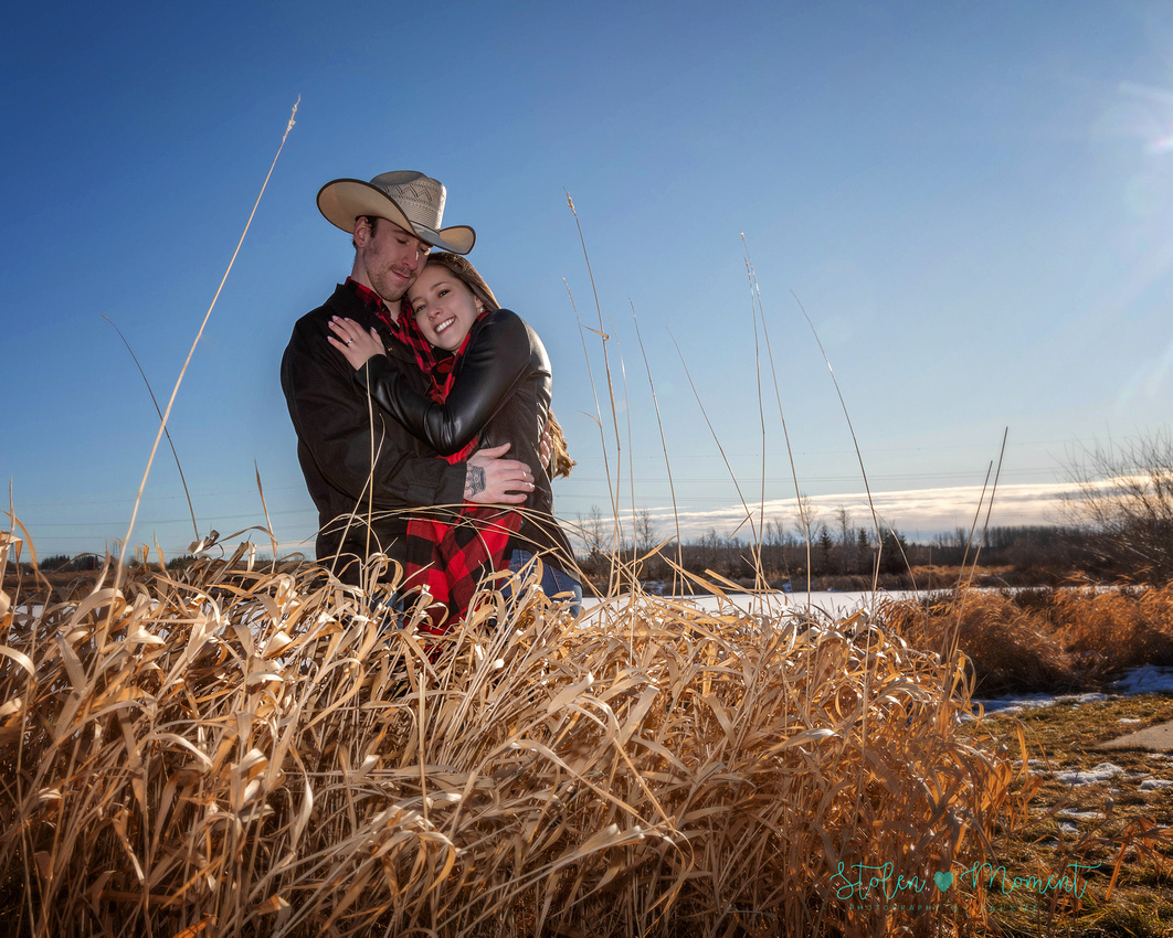 a beautiful engaged couple have their engagement photos done at Lois Hole Centennial Provincial Park