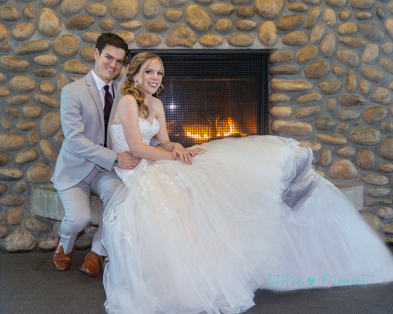 A bride and groom enjoy a winter wedding on a cold day in Edmonton at the church, Jackie Parker park and Mirage Banquet hall