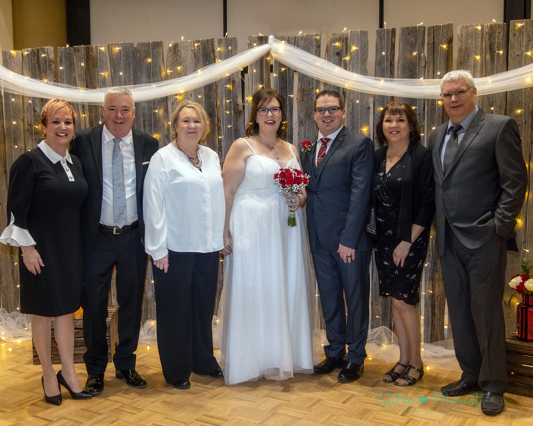 A couple are married in a winter wedding at Festival Place surrounded by family and close friends.