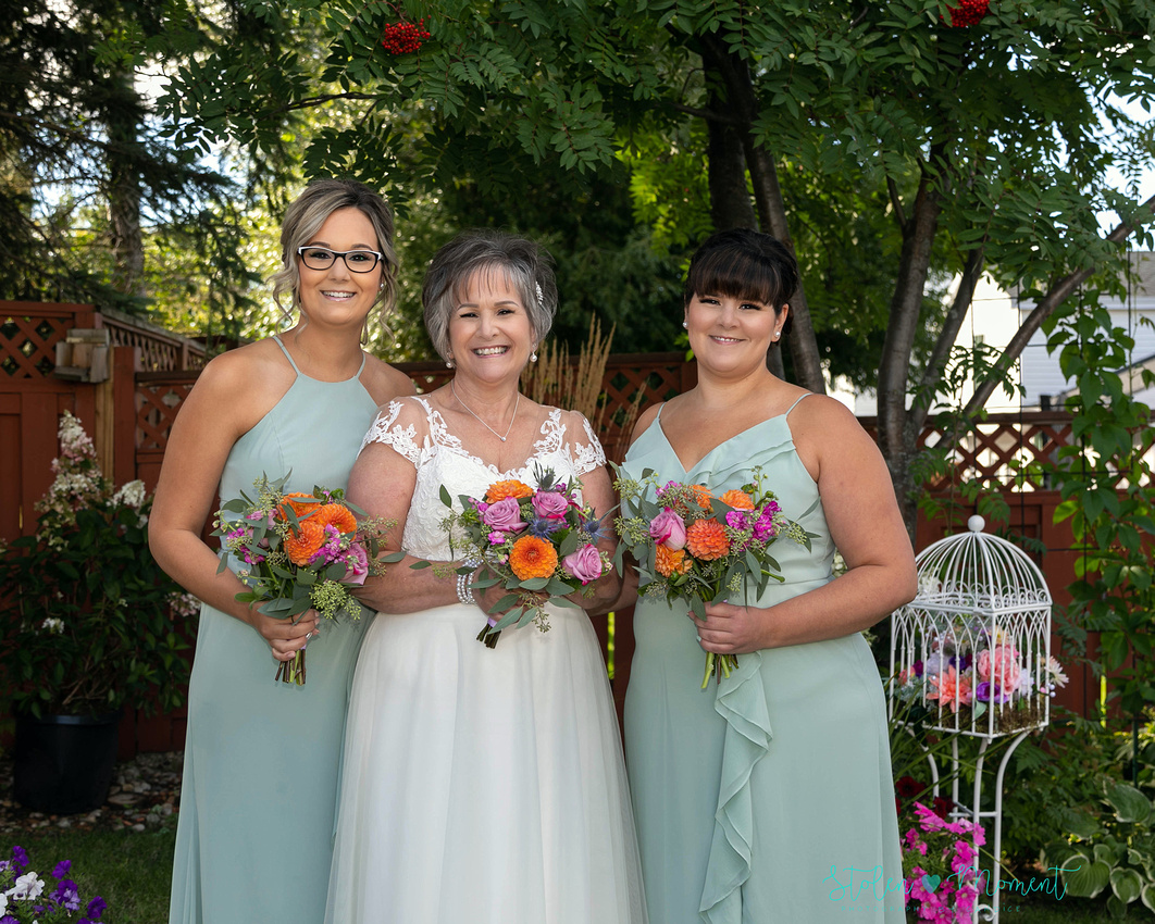 a mature bride and groom are married and witnessed by their families and close friends in a backyard ceremony in Sherwood Park