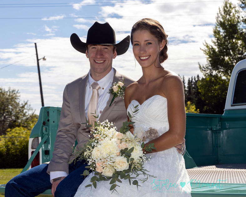 A beautiful bride and groom are married at the St. Albert Grain Elevator Park along with 25 family and friends and then also photographed at the St. Albert Botanical Gardens