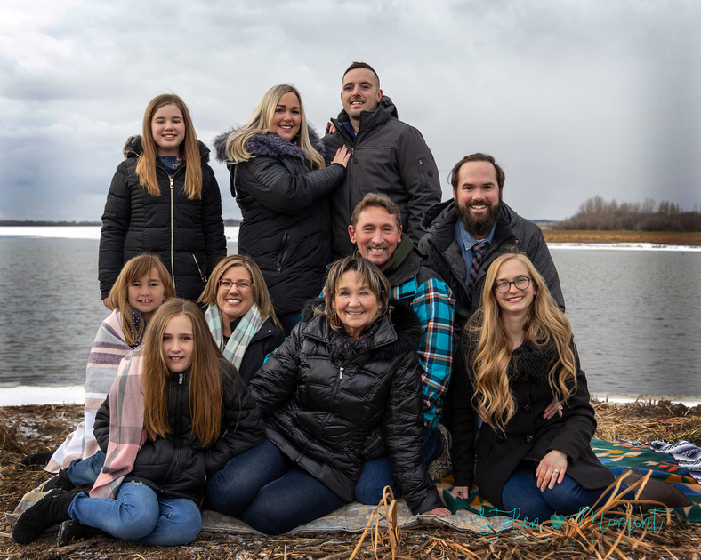 a family of ten is photographed on a wintery day at Lois Hole Centennial Park