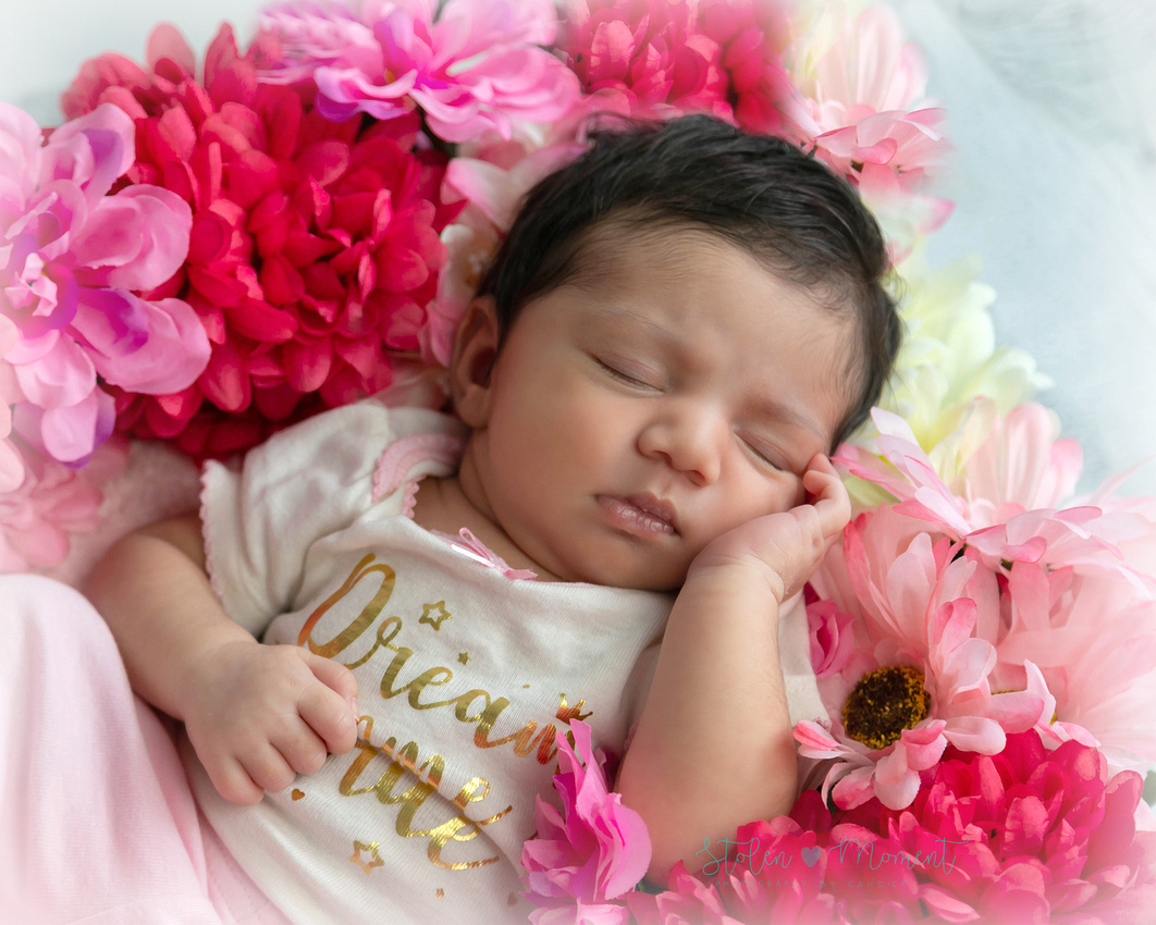 a beautiful newborn girl and her beautiful parents and big sister in studio