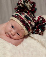 Newborn in adorable hat