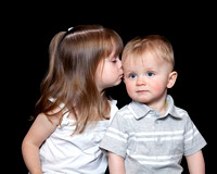 Photo of big sister kissing little brother