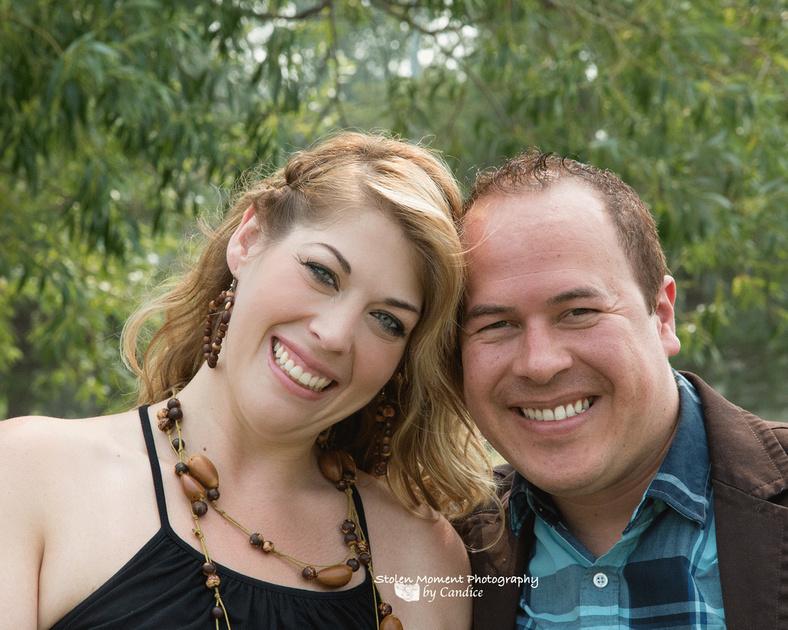 engaged couple smiling at camera