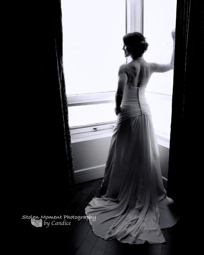Bride in silhouette by window