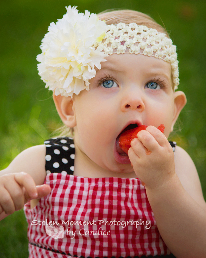 one year old girl eating watermelon