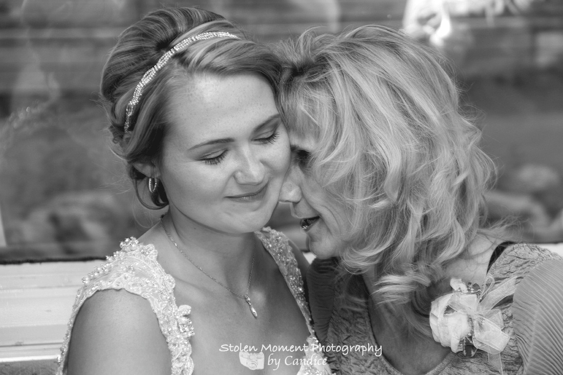 a touching moment between bride and her mother