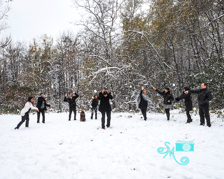 A family of eight gangs up on the dad to throw snowballs at him