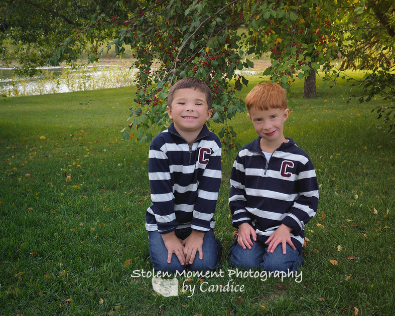 two brothers sitting on the grass