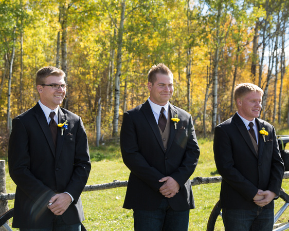 the groom and groomsmen waiting for the ladies