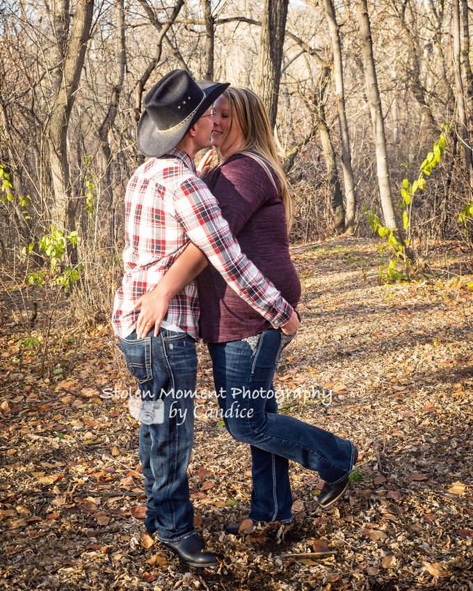 cute shot of engaged couple in the woods