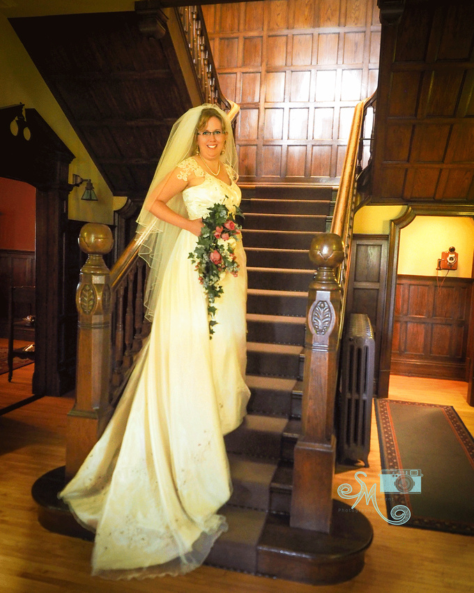 Bride on steps inside Rutherford House