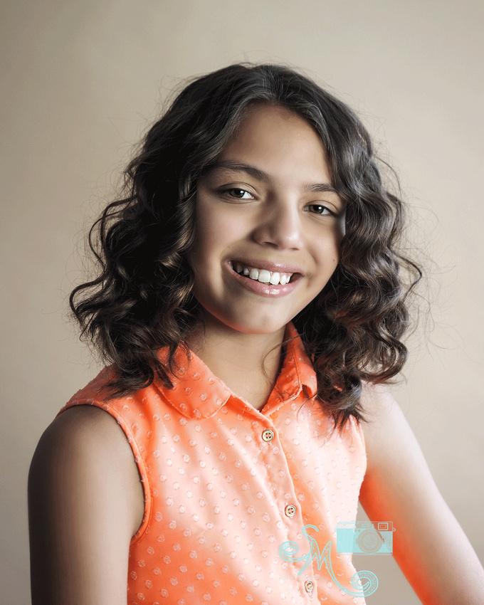 ten year old girl smiling at camera