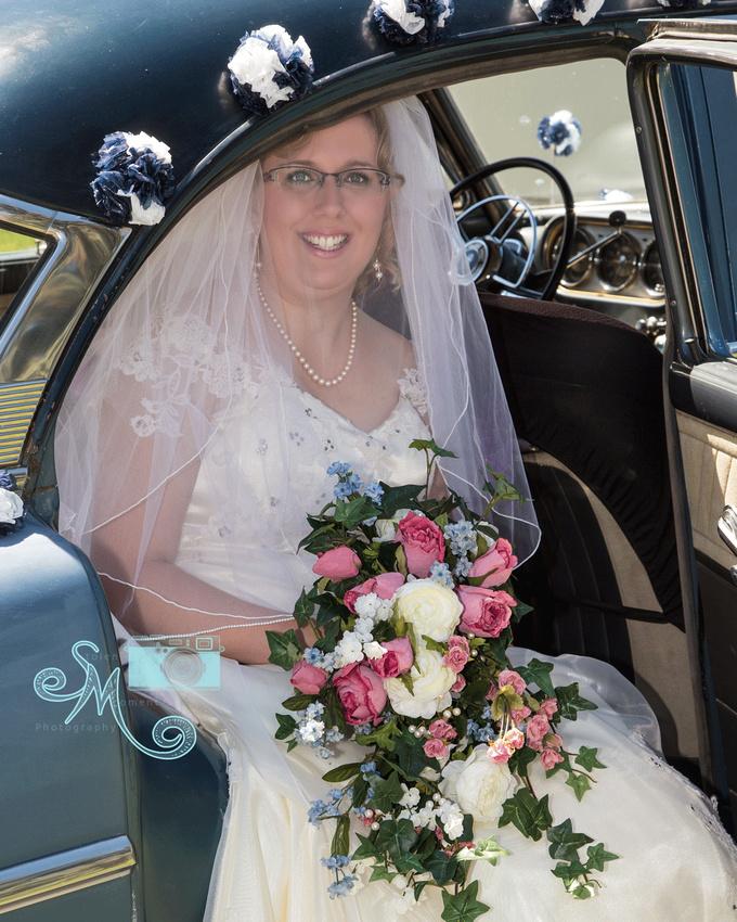 bride sitting in 1952 Packard