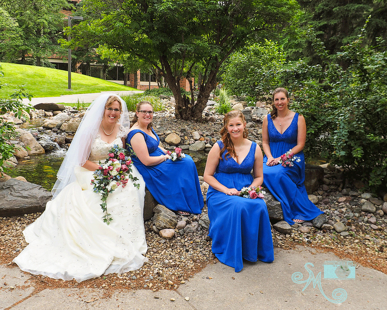 bride and bridesmaids on ground of University of Alberta