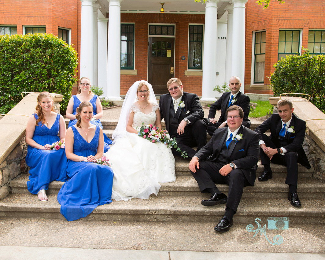 bridal party on steps of Rutherford House