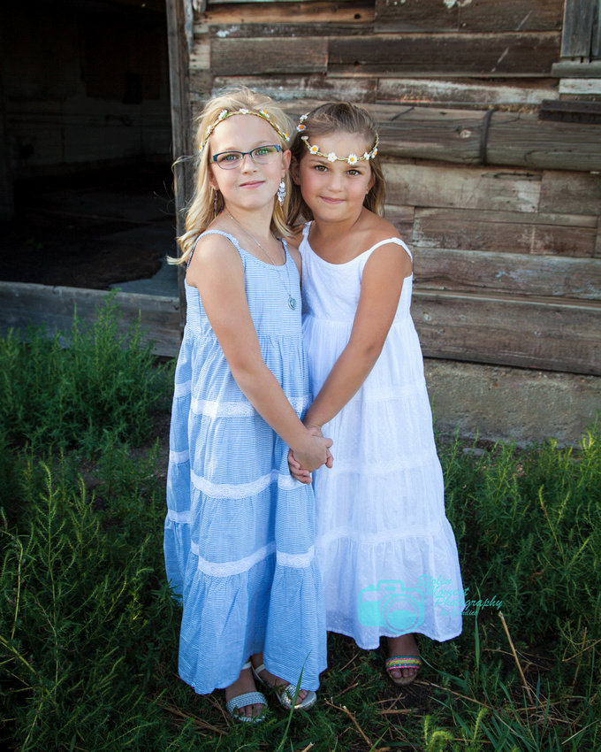 two sisters holding hands in sundresses