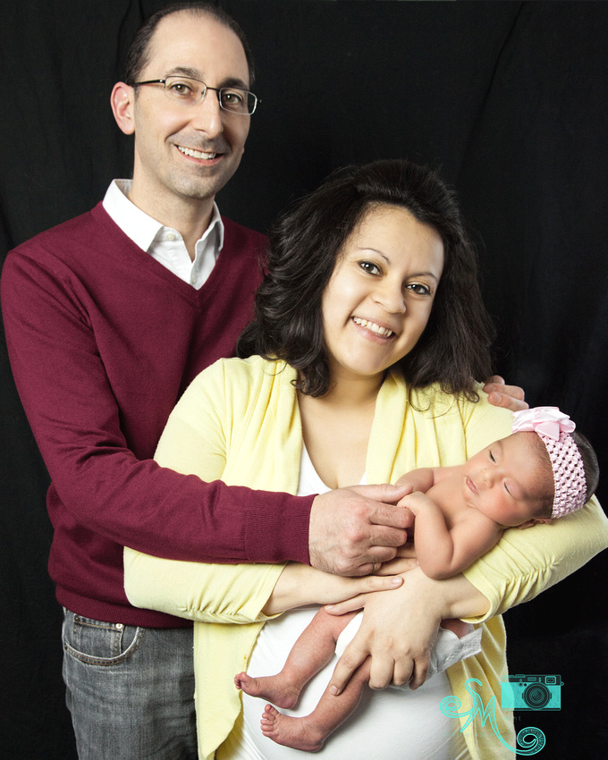Mom and Dad with their newborn daughter