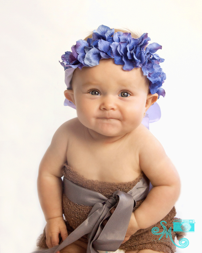 gerber-like baby with purple flower crown
