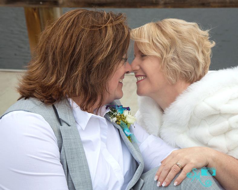 nose kisses between two brides